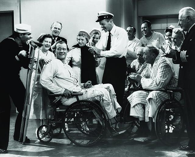 John Wayne, Dan Dailey, Louis Jean Heydt, and Henry O'Neill in The Wings of Eagles (1957)