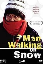 Image of Man Walking on Snow