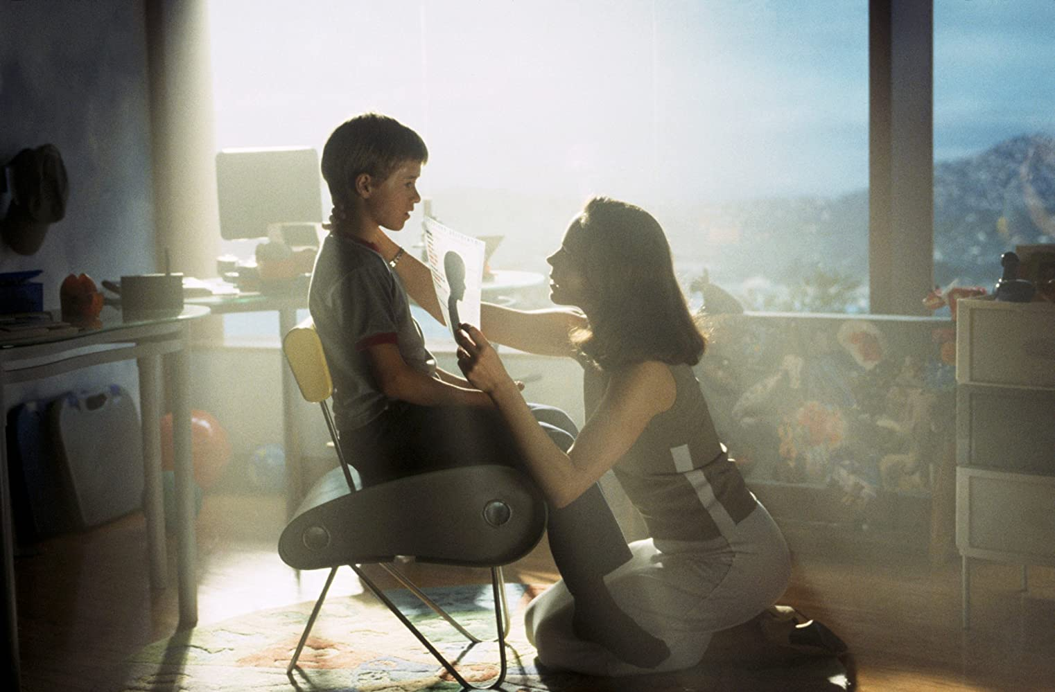 A scene from the movie A.I. Artificial Intelligence: a robotic child gets activated by a woman whose son is in deep coma.