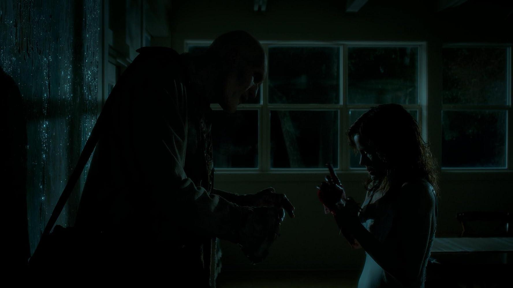 Carla Gugino and Carel Struycken in Gerald's Game (2017)