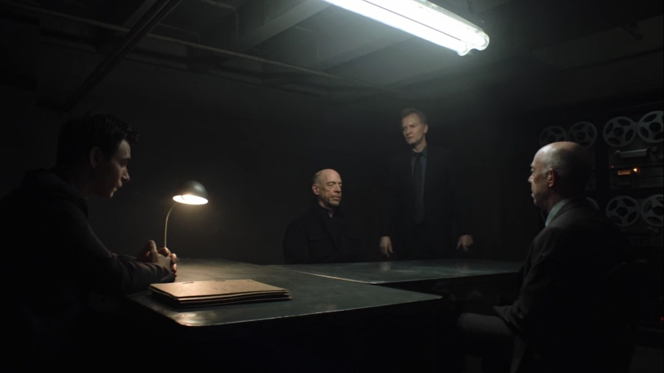 Harry Lloyd and J.K. Simmons in Counterpart (2018)