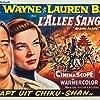 Lauren Bacall and John Wayne in Blood Alley (1955)