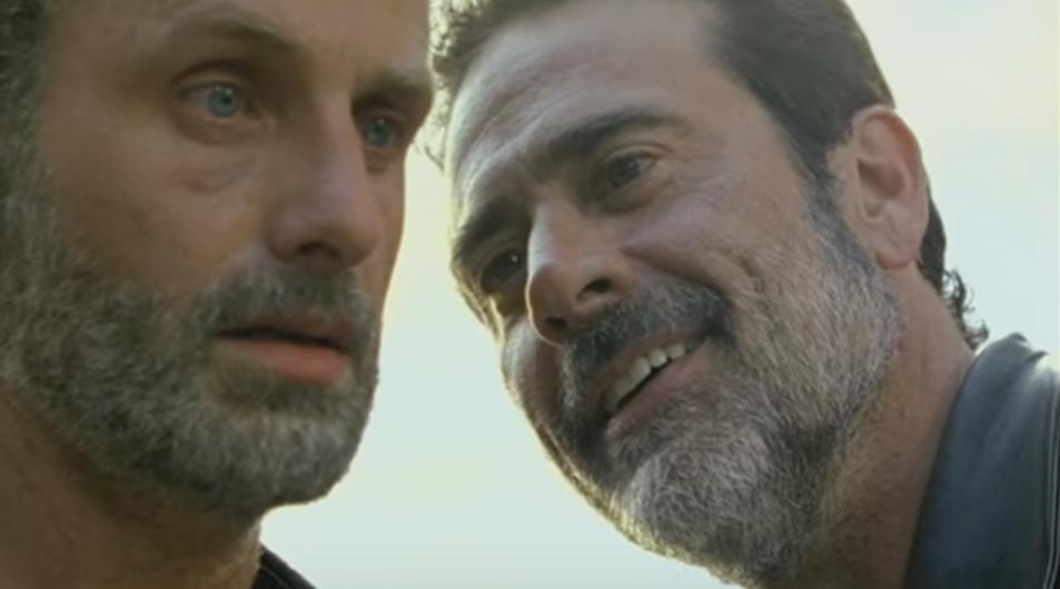 "Photo of Negan and Rick from the TV series, ""The Walking Dead."" Negan is smiling maliciously at Rick, as Rick stares into space hopeless and afraid"