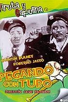 Image of 'Pegando con tubo'
