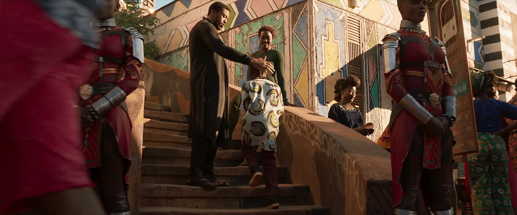 Florence Kasumba, Chadwick Boseman, and Lupita Nyong'o in Black Panther (2018)