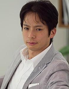 小田 圭二