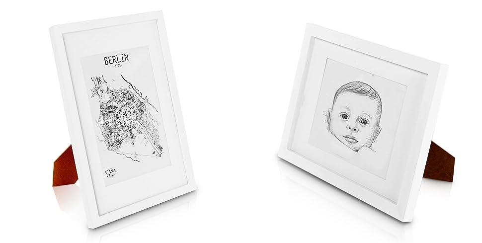 Solida cornice in legno per foto certificati a4 bianco for Cornici foto 15x20