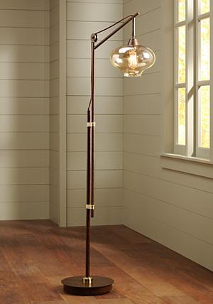 add character and oldtime charm to your living space with this industrial floor lamp the design is crafted from metal and comes in a rich bronze finish
