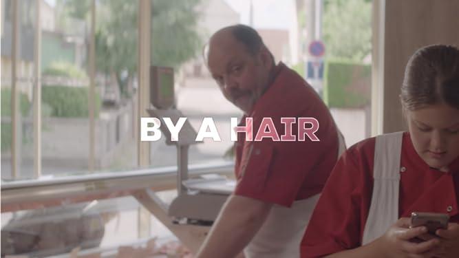 By a Hair