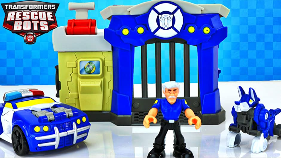 Amazon.com: TRANSFORMERS RESCUE BOTS GRIFFIN ROCK POLICE STATION AND CHASE  THE POLICE BOT: Rescue Bot Chase, Charlie Burns, The Toy Army