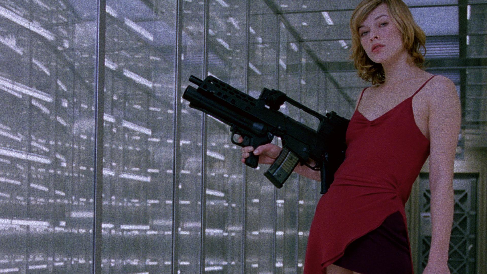 Milla Jovovich as Alice posing with a gun.